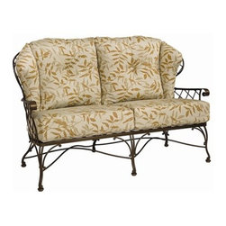 Woodard - Woodard Brayden Cushion Loveseat - The name Woodard Furniture has been synonymous with fine outdoor and patio furniture since the 1930s continuing the company�s furniture craftsmanship dating back over 140 years. Woodard began producing hand-made wrought iron furniture which led the company into cast and tubular aluminum furniture production over the years.� Most recently Woodard patio furniture launched its entry into the all-weather wicker furniture market with All Seasons which is expertly crafted and woven using synthetic wicker supported by an aluminum frame.� The company is widely known for durable beautiful designs that provide attractive and comfortable outdoor living environments.� Its hand-crafted technique used to create the intricate design patterns on its wrought iron furniture have been handed down from generation to generation -- a hallmark of quality unmatched in the furniture industry today. With deep seating slings and metal seating options in a variety of styles Woodard Furniture offers the designs you want with the quality you expect.  Woodard aluminum furniture is distinguished by the purest aluminum used in the manufacturing process resulting in an extremely strong durable product which still can be formed into flowing shapes and forms.� The company prides itself on the fusion of durability and beauty in its aluminum furniture offerings. Finishes on Woodard outdoor furniture items are attuned to traditional and modern design sensibilities. Nineteen standard frame finishes and nineteen premium finishes combined with more than 150 fabric options give consumers countless options to design their own dream outdoor space. Woodard is also the exclusive manufacturer of outdoor furnishings designed by Joe Ruggiero home decor TV personality.� The Ruggiero line includes wrought iron aluminum and all weather wicker designs possessing a modern aesthetic and fashion-forward styling inspired by traditional Woodard patio furniture designs. Rounding out Woodard�s offerings is a line of distinctive umbrellas umbrella bases and outdoor accessories.� These offerings are an integral part of creating a complete outdoor living environment and include outdoor lighting and wall mounted or free standing architectural elements � all made with Woodard�s unstinting attention to detail and all weather durability. Woodard outdoor furniture is an American company headquartered in Coppell Texas with a manufacturing facility in Owosso Michigan.� Its brands are known under the names of Woodard Woodard Landgrave and Woodard Lyon Shaw. With a variety of collections Woodard produces a wide array of collections that will be sure to suit any taste ranging from traditional to contemporary and add comfort and style to any outdoor living space. With designs materials and construction that far surpass the industry standards Woodard Patio Furniture creates beauty and durability that is unparalleled.  Features include Made of extremely durable wrought iron material Hand formed by skilled craftsmen to insure the strongest furniture in the industry Offered in wide selection of powder coated finishes manufactured to prevent rust Offered in wide variety of fabric options for cushions Super comfortable high quality cushions designed for extreme comfort Arm handles are offered for comfort and style. Specifications Seat Height: 21.3 inches.