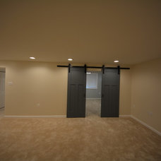 Traditional Basement by ACH Group LLC