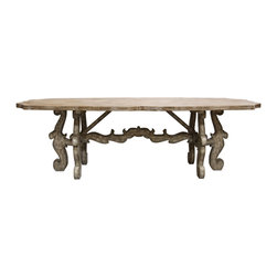 Scroll Farm Table - The Scroll Farm Table takes the construction of the honest, homely trestle table and turns it into a breathtaking piece with a rustic finish and an ornate shape.  Below the gently scalloped oblong tabletop, an opulent yoke-shaped stretcher connects simplified Flemish scroll legs, replicating the sturdy and visibly-supported shape of traditional farm tables but embellishing it with resplendent curves.  This long dining table is ideal for accenting the traditional home's formal dining room with old-world grace.