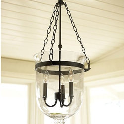 Hundi Lantern, Bronze Finish - This beautiful inverted bell jar is made of handblown glass, which encases a three candle sleeves.