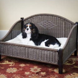 """Mr. Herzher's - Decorative Pet Bed in Dark Brown - Features: -Dark Brown Finish/White pillow bed included. -Rhino-wicker wont absorb fluids or odors. -Easily cleaned with soap. and water. -Removable polycotton cover is machine washable. -Polyfil provides ultimate comfort. -Elevated base & feet protect flooring. -Free flow design reduces mold, mildew and odors. -Small Dimensions: 18"""" H x 28"""" W x 21"""" L. -Medium Dimensions: 18"""" H x 38"""" W x 26"""" L. -Large Dimensions: 18"""" H x 47"""" W x 34"""" L."""