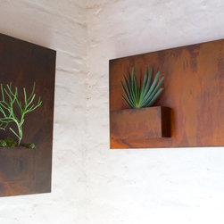 City Planters - Wall planters as art. City Planters add an intriguing dimension to vertical gardening. Hang several on a wall for dramatic impact, or let them shine on their own. A favorite placement for them is the entrance to your home.