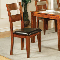 """Steve Silver - Mango Side Chairs - Light Oak - Set of 2 - A modern classic, the Mango Side Chairs (Light Oak) yield functional design and solid wood construction. Defined as casually elegant, the light oak finish and durable chocolate vinyl seat adds depth and character to this truly transitional piece.;Features: Light Oak Finish;Contemporary Style;Corner Block Construction on Chairs and Table;Tongue and Groove Joints;18"""" Seat Height;Solid Wood;Weight: 21.5 lbs.;Dimensions: 19""""L x 22""""W x 40""""H"""