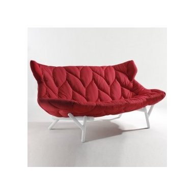 Eco Friendly Furnture and Lighting - Foliage Sofa.Called Foliage, the design features branching thermoplatic legs and a polyurethane foam seat covered in stretchy fabric stitched with a leaf-shaped motif. Material: Frame – batch dyed technopolymer thermoplatic; Seat – polyurethane foam padding with quilted elastic fabric covering; Colours: red fabric, cream frame; cream fabric, acid green frame; green fabric, black frame; petrol blue fabric, hazelnut frame; sugar bag blue fabric, red frame; black fabric, cream frame; sand fabric, cream frame; acid green fabric, red frame.
