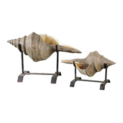 Conch Shell Sculpture - Set of 2 - Recall a summer idyll along the shore, a jaunt to a sun-speckled paradise, a fleeting holiday of sailing and the sea. The Conch Shell Sculpture features natural looking, finely detailed shells on matte black metal stands. Atop a bathroom vanity, a great room side table, or in a summerhouse alcove, the sculpture adds a dash of coastal chic to its surroundings. Available as a set of two.