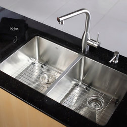 Kraus - Kraus KHU102-33-KPF2140-SD20 Double Basin Undermount Kitchen Sink with Faucet Mu - Shop for Kitchen from Hayneedle.com! Clean and modern in style the Kraus KHU102-33-KPF2140-SD20 Double Basin Undermount Kitchen Sink with Faucet has everything a bustling kitchen needs. The spout easily doubles as a sprayer for rinsing while an integrated soap dispenser is always in reach. You can even multitask thanks to the pair of large basins.Product SpecificationsNumber of Basins: 2Bowl Depth (inches): 10Weight (pounds): 38Low Lead Compliant: YesEco Friendly: YesMade in the USA: YesHandle Style: LeverValve Type: Ceramic DiscFlow Rate (GPM): 2.2Spout Height (inches): 11Spout Reach (inches): 8.75About KrausWhen you shop Kraus you'll find a unique selection of designer pieces including vessel sinks and faucet combinations. Kraus incorporates its distinguished style with superior functionality and affordability while maintaining highest standards of quality in its vast product line. The designers at Kraus are continuously researching and exploring broader markets seeking new trends and styles. Additionally durability and reliability are vital components at Kraus for developing high-quality fixtures. Every model undergoes rigorous testing and inspection prior to distribution with customer satisfaction in mind. Step into the Kraus world of plumbing perfection. With supreme quality and unique designs you will reinvent how you see your bathroom decor. Let your imagination become reality!