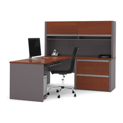 Bestar - Bestar Connexion Bordeaux & Slate 71 x 83 L-Shaped Workstation Desk - The desk is made of durable 1 inch commercial grade work surface with melamine finish that resist scratches stains and wears. It features an impact resistant 0.25 cm PVC edge. Grommets and a rubber strip are available on the station for efficient wire management. The credenza the hutch and the return table meet or exceed ANSI/BIFMA performance standards. The hutch for credenza offers two flip up doors large closed storage space efficient wire management and two large paper shelves. The doors are fitted with strong lift up hardware. The oversized pedestal offers two file drawers with letter/legal filing system. The drawers are on ball-bearing slides and the keyboard drawer features double-extension slides for a smooth and quiet operation. The station is fully reversible. Also available in Slate and Sandstone finish. Connexion is a contemporary and durable collection that features a wide variety of configuration options that will adapt to your specific needs.Nowadays performance productivity and quality of life are fundamental to achieving our personal and professional goals. Bestar's home and office furniture design is based upon these criteria as well as on today's reality. On average we spend about 40 hours a week at work (home or office) which represents a large portion of our time. Various factors have a direct impact on our well-being at work: an important concern in the current employment environment continually changing and at an ever-increasing pace. Therefore organizing your space is certainly a parameter to consider. Features include Strong and large work surface Plenty of room to organize your documents Storage space for your documents and personal items. Specifications Finish/color: Bordeaux & Slate.