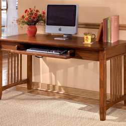 Signature Design by Ashley - Mission Style Writing / Computer Desk - Color/Finish: Dark Oak Stain. Traditional mission styling. Constructed with oak veneers and hardwood solids. Pull-out keyboard tray is covered with black PVC for durability. 60 in. W x 28 in. L x 30 in. H