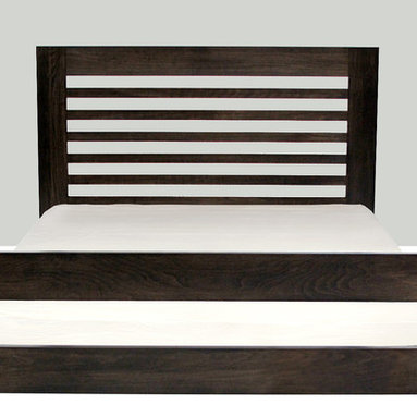 Clyde Queen-size Bed - Clyde shows off the impressive weight and presence of solid wood. Its simple linear form visually anchors it in a space. Choose from a high footboard to frame your mattress or a low footboard, which creates an urban, platform-style bed.