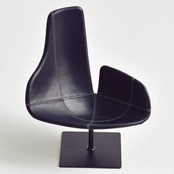 Fjord Relax Chair - Lately it seems every time something catches my eye, it's been designed by Patricia Urquiola. This asymmetrical swivel chair is a contemporary stunner.