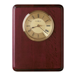 Howard Miller - Howard Miller Honor Time I Plaque Wall/Table Clock - Howard Miller - Wall Clocks - 625255 - This contemporary plaque clock can be customized with an engraving plate to create a memento for your tabletop or wall. Distinguished by its brushed brass tone dial with diamond-cut numeral ring and attractive matching bezel, the Honor Time I Plaque Wall/Table Clock has a nice glow to it. Beautiful hardwood framing in a rosewood finish and quality quartz movement operation complete the look and appeal of this accent clock.
