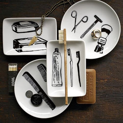 New Menswear Trays - A barbershop quartet. Simple sketches of vintage men's grooming accessories are printed in black on these four white porcelain dishes, adding a fun, retro vibe to bathrooms and dressing tables.
