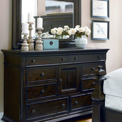 Universal Furniture - Paula Deen Dresser with Mirror in Molasses - Give your guest or master bedroom a makeover by adding the Paula Deen Door Dresser and Landscape Mirror from Universal Furniture. This 8 drawer dresser contains several specialized compartments, such as a drop front pull-out drawer for electronics and a sliding jewelry tray insert. With identical style and finish, the landscape mirror's timeless design is a perfect match for this beautiful dresser. Its classic silhouette and rustic appeal make this set a lovely addition to any bedroom!