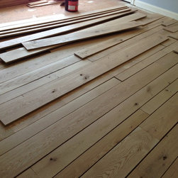 5-7-9 Inch Character White Oak - Character white oak with 5-7-9 inch pattern. Lenghts up to 10ft. Custom free-handed beveling. Glue and nail down installation. Finished with DuraSeal Neutral and Bona Traffic HD Satin
