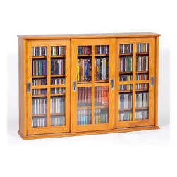 Leslie Dame - Wall-Hung Mission Multimedia Glass Door Cabin - Color: OakSave space and keep your living room or home theater free of clutter with this stylish wall mounted multimedia cabinet. Features glass doors for easy visibility and style along with adjustable shelves that are perfect for your movie, music, and game collections. Holds 525 CD's, 216 DVD's. Pictured in Oak. 47 in. L X 9.5 in. W X 32 3/8 in. H