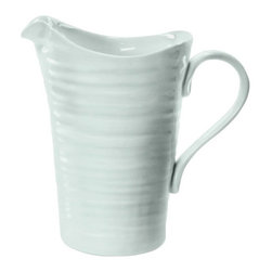 Portmeirion - Sophie Conran Celadon Pitcher / Jug - 422339 - Shop for Pitchers from Hayneedle.com! Complete your dinnerware collection with the Sophie Conran Celadon Pitcher / Jug. This generous pitcher is crafted of durable porcelain. It's freezer microwave oven and dishwasher safe making it the perfect choice for serving up all of your family's favorite beverages and experimenting with new recipes.About PortmeirionStrikingly beautiful eminently practical refreshingly affordable. These are the enduring values bequeathed to Portmeirion by its legendary co-founder and designer Susan Williams-Ellis. Her father architect Sir Clough Williams-Ellis was the designer of Portmeirion the North Wales village whose fanciful architecture has drawn tourists and artists from around the world (including the creators of the classic 1960s TV show The Prisoner). Inspired by her fine arts training and creation of ceramic gifts for the village's gift shop Susan Williams-Ellis (along with her husband Euan Cooper-Willis) founded Portmeirion Pottery in 1960. After 50+ years of innovation the Portmeirion Group is not only an icon of British design but also a testament to the extraordinarily creative life of Susan Williams-Ellis.The style of Portmeirion dinnerware and serveware is marked by a passion for both pottery manufacturing and trend-setting design. Beautiful tactile nature-inspired patterns are a defining quality of Portmeirion housewares from its world-renowned botanical designs modeled on antiquarian books to the breezy natural colors of its porcelain and earthenware. Today the Portmeirion Group's design legacy continues to evolve through iconic brands such as Spode the Pomona Classics collection and the award-winning collaboration of Sophie Conran for Portmeirion. Sophie Conran for Portmeirion:Successful collaborations have provided design inspiration throughout Sophie Conran's life. Her father designer Sir Terence Conran and mother food writer Caroline Conran have been the pilla