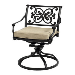 Ballard Designs - Amalfi Swivel Rocker - Coordinates with our Amalfi Outdoor Collection. Basic tan cushions included. Sand black finish resists rust and chipping. Extremely strong, yet light enough for easy placement. Assembly required. Since each piece in the inviting Amalfi Collection is crafted of cast aluminum, the decoration can be more ornate and finely detailed. Seat features an intricate basket weave design with a rich 3-dimensional look. Seat back is beautifully scrolled on both sides, so you can enjoy the pattern from behind. And because cast aluminum is extremely strong and much lighter than it looks, pieces place easily and yet feel reassuringly sturdy. Amalfi Swivel Rocker features: . . . . . Replacement cushions available. Requires 1 replacement cushion set per rocker. Use of an outdoor furniture cover is recommended to extend the life of your piece.