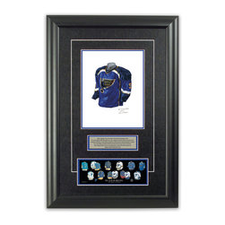 """Heritage Sports Art - Original art of the NHL 2007-08 St. Louis Blues jersey - This beautifully framed piece features an original piece of watercolor artwork glass-framed in an attractive two inch wide black resin frame with a double mat. The outer dimensions of the framed piece are approximately 17"""" wide x 24.5"""" high, although the exact size will vary according to the size of the original piece of art. At the core of the framed piece is the actual piece of original artwork as painted by the artist on textured 100% rag, water-marked watercolor paper. In many cases the original artwork has handwritten notes in pencil from the artist. Simply put, this is beautiful, one-of-a-kind artwork. The outer mat is a rich textured black acid-free mat with a decorative inset white v-groove, while the inner mat is a complimentary colored acid-free mat reflecting one of the team's primary colors. The image of this framed piece shows the mat color that we use (Medium Blue). Beneath the artwork is a silver plate with black text describing the original artwork. The text for this piece will read: This original, one-of-a-kind watercolor painting of the 2007-08 St. Louis Blues jersey is the original artwork that was used in the creation of this St. Louis Blues uniform evolution print and tens of thousands of other St. Louis Blues products that have been sold across North America. This original piece of art was painted by artist Nola McConnan for Maple Leaf Productions Ltd. Beneath the silver plate is a 3"""" x 9"""" reproduction of a well known, best-selling print that celebrates the history of the team. The print beautifully illustrates the chronological evolution of the team's uniform and shows you how the original art was used in the creation of this print. If you look closely, you will see that the print features the actual artwork being offered for sale. The piece is framed with an extremely high quality framing glass. We have used this glass style for many years with excellent results. W"""