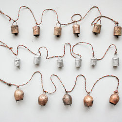Beautiful Windchimes by Irona - Hand-forged from recycled metals, Irona's mini bells make for charming Christmas decor. And as the weather warms, you can also use them as wind chimes.