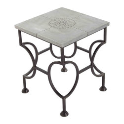 Westerly Iron/Metal Side Table - Bring eye-opening shape to your room in traditional metallics by adding the Westerly Side Table.  Like the coordinating line of Westerly surfaces, the table has a simply-shaped top covered in oxidized zinc foil that is studded with decorative brads to form the shape of a highly stylized rayed sun.  Its black iron legs, however, bring true innovation to the shape, as each corner vertical splits into a right-angled ring, creating a blocky hourglass that sets a bold tone in transitional rooms.
