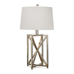 Kathy Kuo Home - Leonardo Modern Silver Metal Geometric Table Lamp - Balancing beauty and function, this modern silver table lamp has a geometric presence. Intersecting rectangles crossed in the center by diagonal lines form a three-dimensional prism as the base of this beautiful light. The contrasting round drum shade in bright white adds a clean, crisp finishing touch.