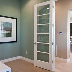 Doors - Transition from room to room while maintaining an open look and feel with a floor-to-ceiling door featuring glass-panel insets. Photo courtesy of Infinity Homes.