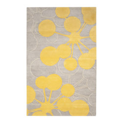 Bright Organic Rug - Ground your guest room with a bright hand-tufted wool rug. A warm gray keeps things neutral, while lemon-yellow bulbs add a pop of freshness.