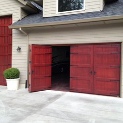 Bi-fold Carriage Doors - Portland, OR - Large bi-fold carriage door panels fabricated by Singcore and finished and installed by Best Overhead Door, LLC (www.bestohd.com).  Private residence in Portland, OR.