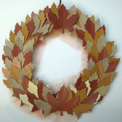 Autumn Harvest Leaves Fall Wreath by Bubble Gum Dish - This is different — in a good way. The paper leaves, metallic spray paint and golden tulle are sure to be a conversation starter at Thanksgiving.
