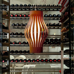 Farolillo Thin Suspension Light - Farolillo was designed by the components of Australian studio Bang Design, Brian Marshall and David Granger. It helps us recover those delightful moments as children, when we used to decorate trees with paper lanterns for a party. The paper lantern has always evoked a sensation of familiarity and kindness. This lamp was specifically designed for LZF and has two pieces: an inner, cylindrical shade made of white cotton, and an outer one in die-cut wood which allows the object to be expanded or compressed, to allow adaptation to the different environments.