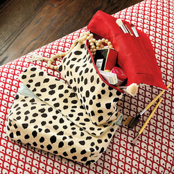 Ballard Designs - Dodie Dalmatian Print Cosmetic Bag - Laminated interior for easy cleaning. Wipes clean with damp cloth. This fashionable fold-over clutch transforms into a handy cosmetic bag. Zippered pouch holds your cosmetics while the fold-over flap has pockets for brushes, eyeliner, lip gloss and more. Choose red or spa interior lining. Dodie Dalmatian Print Cosmetic Bag features: . .