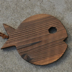 Fish Trivet - This adorable fish-shape trivet is made from smoked Kiri wood. This piece is sure to make you smile when cooking!