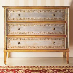 Versailles Chest - A gorgeous piece in every way, this chest gets its beautifully unique look from the gold-leaf pattern applied to the back of the silvered-glass top, sides and drawer front using a centuries-old verre eglomise technique.  The chest is made from solid walnut and is designed with fluting and square tapered legs.