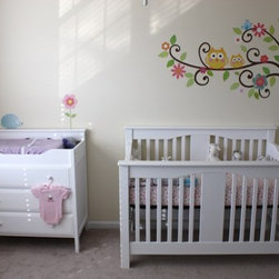 Baby's Nursery - Bird and Owl Tree Wall Mural Set. Both sophisticated and fun, you'll love livening up your walls with this tree! Featuring funky, curly branches, brightly-colored flowers, and some friendly feathered friends, our Scroll Tree is the perfect touch to nurseries, bedrooms, and playrooms. Every element is repositionable, meaning it's easy to move the tree around as you like. No need to worry about getting it perfect on the first try! There is no need for paste or water - simply peel the applique or border off the backing and apply to the wall - or any smooth surface.