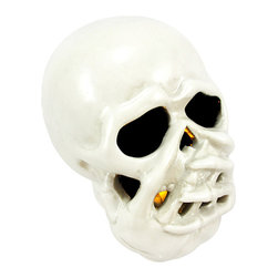 Bethany Lowe Halloween SPEAK NO EVIL Ceramic LED Light - Made of ceramic, this `Speak No Evil` skull decoration contains a battery powered yellow LED light, that emits a soft glow in dark conditions. The skull measures 3 3/4 inches tall, 4 inches deep and 3 inches wide. It runs on 2 button cell batteries (included).
