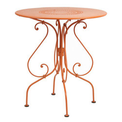 Fermob - 1900 Round Table - Small - Fermob - 1900 is one of the oldest collections from Fermob, a romantic range, featuring the handiwork of a blacksmith. It tells the tales of the early 20th century gardens in the French countryside. Tabletops and seats made from perforated lacquered steel. Available in all Fermob colors. The smallest 1900 Table is 26 inches in diameter and is made of lacquered steel that has a very high protection cataphoresis finish making it good for outdoor use. The scrolls and rings are still hand forged by a blacksmith in France. The table top is perforated and includes a parasol hole. Seats two. Fermob furniture undergoes several stages of rust proofing followed by two paint stages: a Fermob exclusive process in one of the most efficient plants in Europe. The paint is a DuPont powder, 100 percent polyester, anti UV, deposited electrostatically on the furniture for optimal coverage, then baked at 193 degrees, just like in the car industry. Ecological paint protects both the environment and your health: the powder paints used by Fermob contain no solvents. They are 100 percent recyclable and are recycled in a zero waste installation.