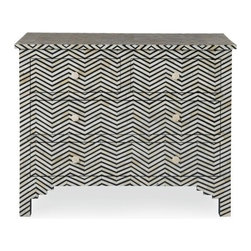 Bone Inlay Chevron Chest Black & White (Limited) - This fabulous bone inlay Herringbone chest is a remarkable feat of superior craftsmanship and design. Painstakingly created from wood solids the finished overlay features bone inlays formed and shaped in a fabulous chevron pattern, with beautiful drawer pulls and curved legs. Variations in bone inlay are not uncommon, giving each piece one-of-a-kind distinction.This wonderfully ornate Bone Inlaid takes a team of skilled craftsmen to complete. Individual pieces of reliably sourced camel bone have been skillfully carved and fixed into black resin on a wooden frame to create these items.