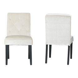 Cortesi Home - Anastasia Dining Chair (Set of 2) - The Anastasia chair is modern luxury with its featured diamond tufting. This dining chair is upholstered in a cream velvet fabric and adorned with a piping trim detail. A solid wood frame is used for strength and durability and the finishing touches are matte black legs.