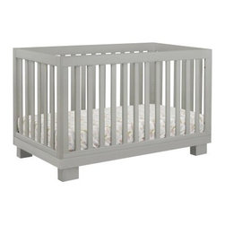 Babyletto Modo 3-in-1 Convertible Crib - Gray - The beautiful Babyletto Modo 3-in-1 Convertible Crib - Gray is perfect for parents who love modern sophistication along with practicality. This gorgeous crib grows with your child, converting from a crib to a toddler bed to a daybed as your child grows. Crafted from solid and sustainable New Zealand pine wood, this convertible crib has a rich, non-toxic finish and is lead and phthalate safe. As your baby grows taller and more mobile, you're able to adjust the mattress down to four different levels to help prevent her from climbing out. The all slat sides also make it easy to see your child from any angle. Hardware is safely and cleanly hidden away and a toddler rail is included. JPMA certified, this crib also meets ASTM and US safety requirements. Additional Features Beautiful non-toxic finish All slat sides makes it easy to see your baby Hardware is safely and cleanly hidden away Lead and phthalate safe Fixed side rails JPMA certified Meets ASTM and US safety requirementsOptional 3-drawer dresser changer has removable changing tray About BabylettoModern and stylish while remaining affordable and eco-friendly, Babyletto is a brand with a vision. Established in 2010, Babyletto takes pride in offering quality products for families, all designed to open the heart and spark imagination. Working from a platform based on fond childhood memories and special moments, they strive to infuse every design with an essence of honesty and creativity while crafting each piece with impeccable quality. Safety is at the forefront of each and every thing they produce, and a long-standing relationship with their producers helps to maintain this commitment as well as their dedication to eco-friendly manufacturing.