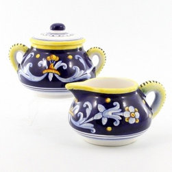 Artistica - Hand Made in Italy - ANTICO DERUTA: Creamer and Sugar Bowl Set - ANTICO DERUTA Collection: Throughout the years, our Antico Deruta collection has been always considered the most formal depiction of the Ricco Deruta pattern. Its classic Arabesque decorative pattern is composed of rhythmic, curvilinear designs painted in a unique combination of regal blue and bright yellow. The foliated scrollwork motif featured in this collection was also employed in the architectural decorations of late Roman and Renaissance periods.
