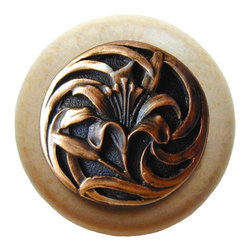 """Inviting Home - Tiger-Lily Natural Maple Wood Knob (clear finish with antique copper) - Tiger-Lily Natural Maple Wood Knob in clear finish with hand-cast antique copper insert; 1-1/2"""" diameter Product Specification: Made in the USA. Fine-art foundry hand-pours and hand finished hardware knobs and pulls using Old World methods. Lifetime guaranteed against flaws in craftsmanship. Exceptional clarity of details and depth of relief. All knobs and pulls are hand cast from solid fine pewter or solid bronze. The term antique refers to special methods of treating metal so there is contrast between relief and recessed areas. Knobs and Pulls are lacquered to protect the finish. Alternate finishes are available. Detailed Description: A very detailed and beautiful knobs are the Tiger Lily knobs. They are very delicate and bears a lot of positive history. The Tiger Lily is an orange flower that is covered in spots. It has been a useful medical remedy for many centuries. Its scent is said to suppress aggressive behavior and promotes overall good feeling. The smell is said as a superstition to give whoever smells it freckles."""