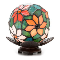 Warehouse of Tiffany - Floral Ball Art Glass Table Lamp - Requires one 25-watt Type A bulb (not included). Operates with a line switch. Setting: Indoor. Antique bronze finish. Minimal assembly required. 5.5 in. Dia. x 6.5 in. HA petal-shaped bronze base lends earthy style to this garden-inspired table lamp. Crafted with Tiffany-style art glass, this fascinating light fixture houses a single bulb in a colorful green floral-patterned spherical shade.