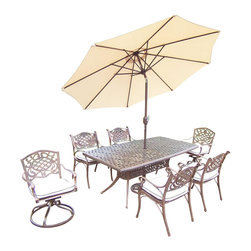 Oakland Living - 9-Pc Patio Dining Set - Includes one dining table, four arm dining and two swivel rockers with cushions, crank and tilting umbrella and base. Boat shaped table. Metal hardware. Fade, chip and crack resistant. Umbrella hole. Traditional lattice pattern and scroll work. Warranty: One year limited. Made from rust free cast aluminum. Antique bronze hardened powder coat finish. Minimal assembly required. Table: 70 in. L x 38 in. W x 29 in. H (75 lbs.). Arm chair: 21.5 in. W x 23 in. D x 34 in. H (27 lbs.). Swivel rocker chair: 23 in. W x 17.5 in. D x 38 in. H (33 lbs.)This 9 pc Table dining set is the prefect piece for any outdoor dinner setting. Just the right size for any backyard or patio. The Oakland Mississippi Collection combines southern style and modern designs giving you a rich addition to any outdoor setting. Each piece is hand cast and finished for the highest quality possible.