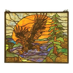 "Meyda Tiffany - 20""W X 16""H Eagle At Sunset Stained Glass Window - A majestic Bronze Eagle soars against an golden Sunset in a picturesque woodland setting of Pine Green and Earth Brown. This handsome window is handcrafted utilizing the copper foil construction process and 323pieces of stained art glass encased in a solid brass frame. Mounting bracket and chain are included."