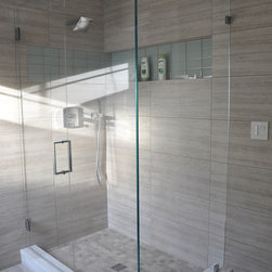 New England Bathroom - This stunning shower design showcases Seta glazed porcelain 12x24 tiles on the floor and walls in Beige. The shower floor also displays Silver Sand natural stone in a 2x2 mosaic.