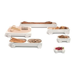 Y'a Pas Le Feu Au Lac - Y'a Pas Le Feu Au Lac Kart - A family of playful wooden serving dishes on wheels. Roll one to a friend, to share the bread, butter or snacks. Or race them against each other in jest. The simple, pared-down design puts the food centre-stage, while encouraging interaction and sharing.