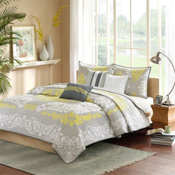 Madison Park - Madison Park Cameo 6 Piece Coverlet Set - Add a splash of color to your bedroom with Cameo. This coverlet features a white and yellow print that stands out on a gray background with white piping. The embroidered detailing on the three decorative pillows pulls the whole look together. This coverlet set also includes two matching standard shams. With a microfiber polyester face and a brushed fabric reverse, this coverlet is soft to the touch and machine washable for easy care. Coverlet & Sham: 100% cotton printed with all over quilting, 100% polyester brushed fabric reverse Filling: 200g/m2 cotton pre-washed Pillow: cotton shell, polyester filling