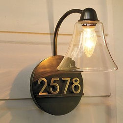 "Mayfair Sconce - This sconce kills two birds with one stone. I've never seen a more clever way to light up the front stoop and display house numbers.Details Overall: 10.5"" wide x 8"" deep x 13.5"" high Shade: 7.5"" diameter, 5.5"" high House Numbers: 1.75"" wide x 0.5"" deep x 2.5"" high Back Plate: 8"" diameter, 1.5"""