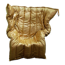 Gold Metallic Armchair - Eclectic and bold, this metallic armchair would certainly make a statement in any space.