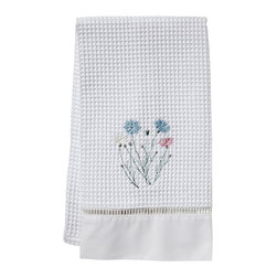 Jacaranda Living - Wildflowers Waffle Weave Guest Towel - Delicate wildflowers, embroidered against a white background, is the focal point of this compelling towel. This simple yet memorable, waffle weave guest towel has been trimmed with ladder lace and cotton percale, and was made by Zulu women in South Africa, in a socially responsible environment. This is a towel you can feel good about hanging in your bathroom.